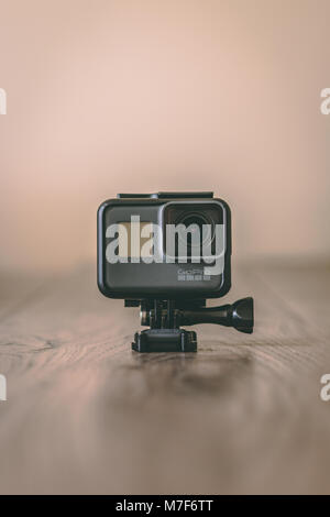 March 10th, 2018, Cork, Ireland - GoPro Hero 5 Black 4K action camera on top of a wooden table against a light background - Stock Photo