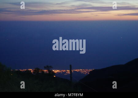 View to Porto Novo and the Atlantic at night, from Biosfera Amor do dia in Lombo de Figueira, Santo Antao Island, - Stock Photo