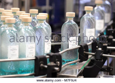 Embargoed to 0001 Sunday March 11 File photo dated 18/10/16 of gin bottles on the production line at the Isle of - Stock Photo