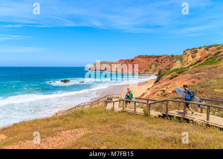 PRAIA DO AMADO BEACH, PORTUGAL - MAY 15, 2015: Surfers with boards walking to beach on sunny beautiful day. Water - Stock Photo