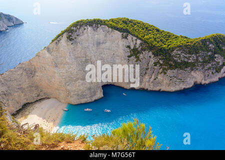 Beautiful blue sea and cliffs. Navagio Beach in Zakynthos island, Greece - Stock Photo