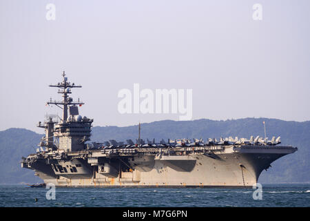The United States aircraft carrier, USS Carl Vinson, anchored off the coast at Tien Sa Port on March 5, 2018 in - Stock Photo