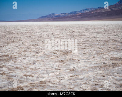 Salt flat at Badwater Basin at Death Valley National Park, with 282 feet (86 m) below sea level the lowest point - Stock Photo