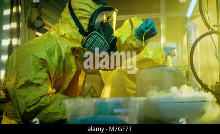 In the Underground Drug Laboratory Two Clandestine Chemists Wearing Protective Masks and Coveralls Test Cooked Drug's Purity and Strength.