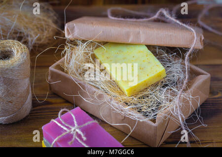 Handmade spa soap on old vintage wooden background. Soap making. Soap bars. Spa, skin care. - Stock Photo
