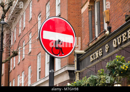 Clet Abraham road sign street art graffiti of wheelchair user on no entry sign, London, UK - Stock Photo