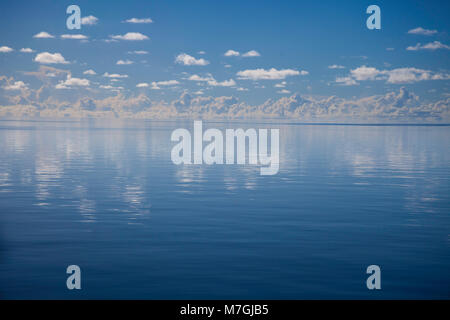 A glassy flat day on the ocean off the island of Yap, Micronesia. - Stock Photo