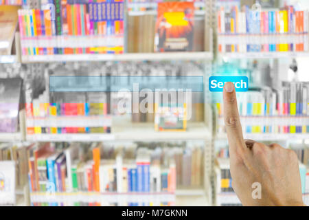 Hand pushing on search engine button and abstract blur books on the shelf in library in the background. Representing - Stock Photo