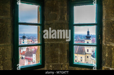 Sibiu Council Tower and Holy Trinity Roman Catholic Church viewed from the Evangelical Church. - Stock Photo