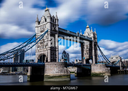 Low angle long exposure of Tower Bridge over the river Thames in London UK - Stock Photo