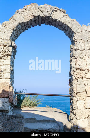 Ancient arch in the fortress on Cape Kaliakra, the Bulgarian Black Sea coast - Stock Photo