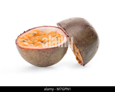 Two halves of passion fruit isolated on white, clipping path included - Stock Photo