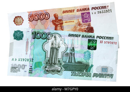 Russian banknotes of a thousand and five thousand rubles, isolated on a white background. - Stock Photo