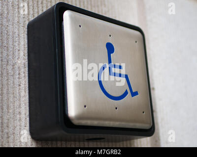 Push to open button for disabled - Stock Photo
