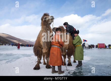 Hatgal, Mongolia, 3rd March 2018: mongolian people on a frozen lake Khuvsgul during a ice festival in winter - Stock Photo