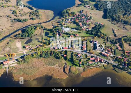 Aerial view of Ogonki - tourist resort in Masuria District located between Swiecajty and Stregiel Lakes, Sapina - Stock Photo