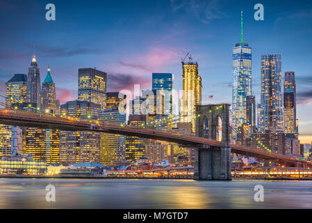 New York City, USA skyline on the East River with Brooklyn Bridge at dusk. Stock Photo