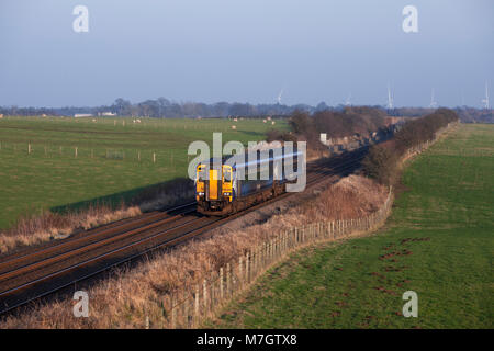 A Scotrail class 156 sprinter train passes Rigg (West of Gretna Green) with the 1323 Newcastle - Glasgow Central - Stock Photo