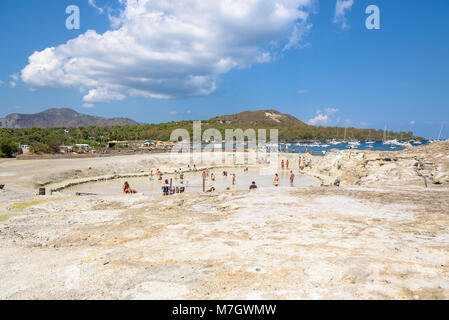 Vulcano Island, Italy - August 22, 2017: People having a healthy warm mud and sulfur bath. - Stock Photo