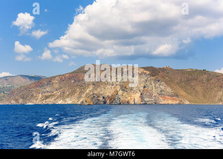 Rocky cliff coast of the Lipari Island seen from the sea, Aeolian Islands, Italy - Stock Photo
