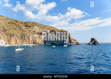 Yachts at the rocky coast of Lipari Island, Aeolian Islands, Italy - Stock Photo