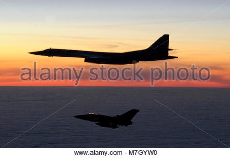 A Russian Tupolev Tu-160 Blackjack is escorted by a Panavia. A Russian Tu-160 Blackjack is escorted by a Tornado - Stock Photo