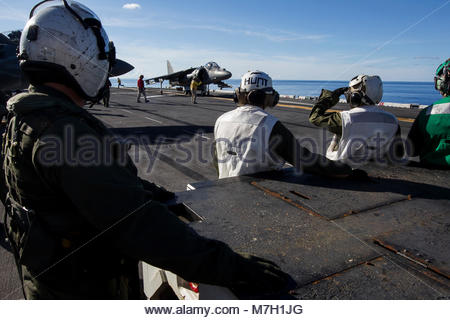 McDonnell Douglas (now Boeing) AV-8B Harrier. OCEAN (June 14, 2017) Marines assigned to Marine Attack Squadron (VMA) - Stock Photo