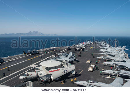 USS George HW Bush (CVN 77). STRAIT OF GIBRALTAR (July 24, 2017) Sailors gather on the flight deck of the aircraft - Stock Photo