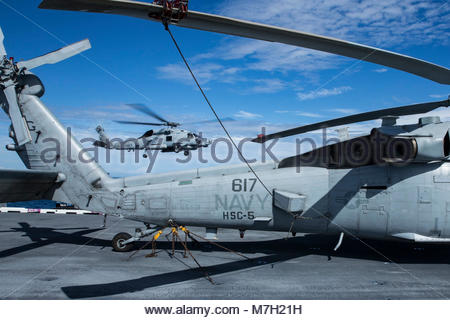 Sikorsky MH-60R Sea Hawk or Seahawk ( MH-60S is shown. OCEAN (Aug. 4, 2017) An MH-60R Sea Hawk helicopter assigned - Stock Photo