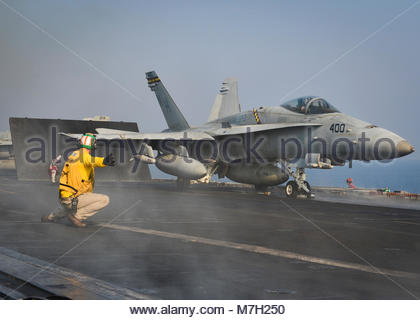 """McDonnell Douglas FA-18C Hornet. GULF (Sep. 2, 2017) Sailors and Marines launch an F/A-18C Hornet from the """"Death - Stock Photo"""