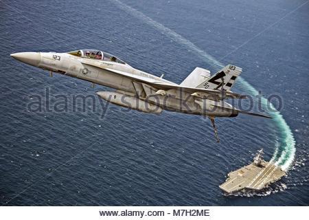 Boeing FA-18F Super Hornet (BuNo 166969) of VX-23 (STRIKE TEST. A Navy Boeing F/A-18F Super Hornet flies over the - Stock Photo