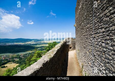 View of ruins of medieval Chojnik castle situated on the top of high hill covered with forest in Jelenia Gora, Poland