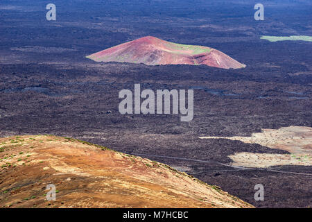 Islote de Montana Bermeja.  A volvanic cone isolated in lava field.  Viewed from Caldera Blanca, Lanzarote, Canary - Stock Photo