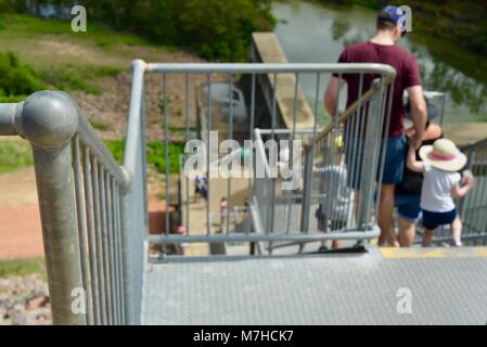Father and son walking down galvanised steel stairs, Ross River Dam, Ross Dam Access, Kelso QLD, Australia - Stock Photo