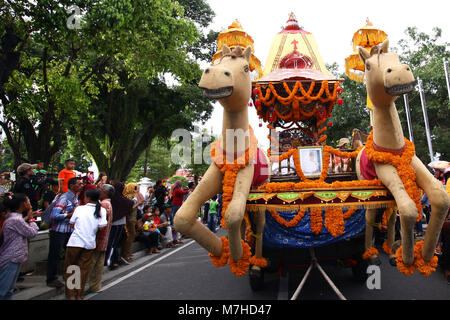 Yogyakarta, Indonesia. 10th Mar, 2018. Hindus carrying the Ratha Yathra (God Train) when held a Ogoh-Ogoh Parade - Stock Photo
