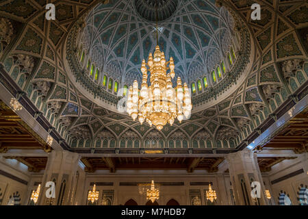Giant cristal chandelier in the main prayer room of Sultan Qaboos Grand Mosque in Muscat, Oman - Stock Photo