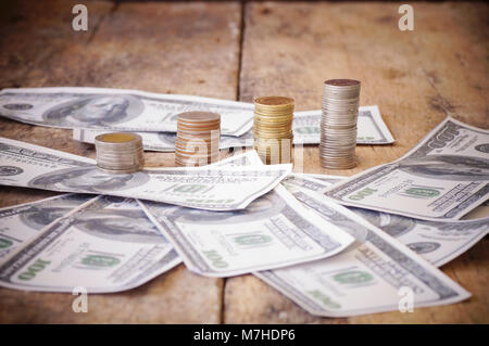 skull on bank note and coin, money, concept in work for money and death because of money - Stock Photo