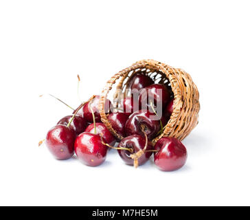 Cherries  in wicker basket isolated on white background - Stock Photo