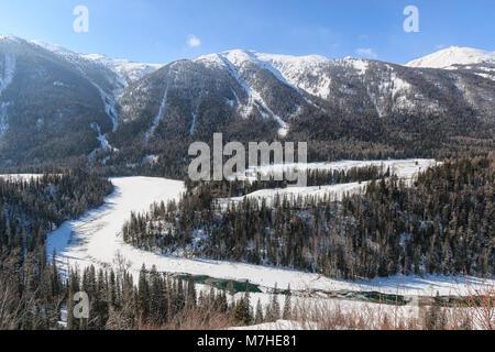 Crescent Moon Bend or Yue Liang Wan in Winter, Kanas Lake, Kanas Nature Reserve, Xinjiang, China - Stock Photo