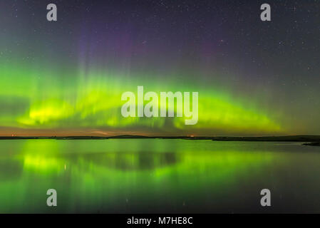 The northern lights and a faint display of noctilucent clouds above Crawling Lake, Canada. - Stock Photo