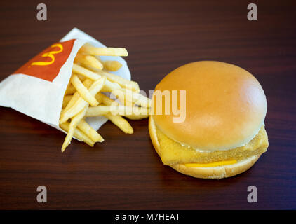 A McDonald's Filet-O-Fish, a fish sandwich, and a small french fries. - Stock Photo