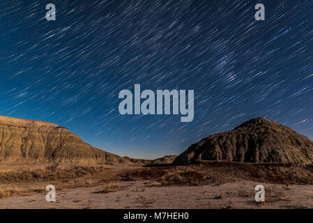 Star trails at Dinosaur Provincial Park, Alberta, Canada. - Stock Photo
