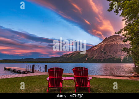Red chairs in the sunset light at Waterton Lakes National Park, Canada.