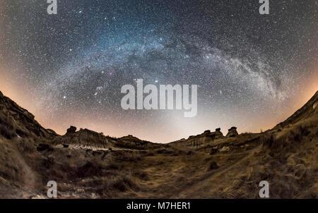 Winter Milky Way and zodiacal light at Dinosaur Provincial Park, Alberta, Canada. - Stock Photo