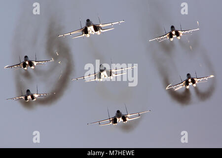 Formation of Su-27 and MiG-29 Russian jets flying in formation. - Stock Photo