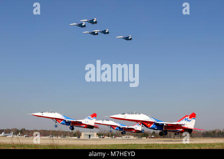 Su-27 of the Russian Knights and MiG-29 jets of the Swifts Russian aerobatics teams. - Stock Photo