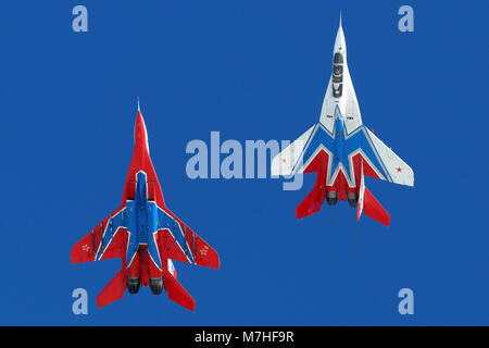MiG-29UB jet fighters of the Russian Swifts aerobatic team. - Stock Photo