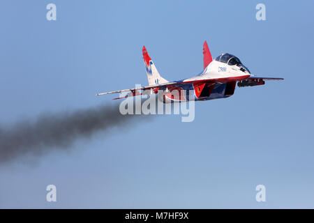 MiG-29UB jet fighter of the Russian Swifts aerobatic team. - Stock Photo