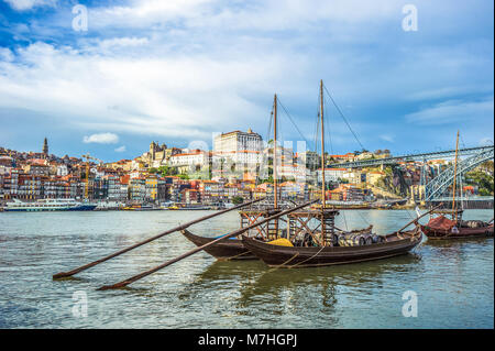 Rabelo, traditional boat with wine barrels in Porto, Portugal - Stock Photo
