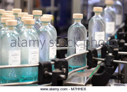 File photo dated 18/10/16 of gin bottles on the production line at the Isle of Harris Distillery in Scotland's Western - Stock Photo